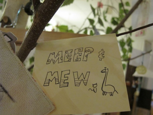 Cute drawing hanging on a tree in Giraffe Cafe